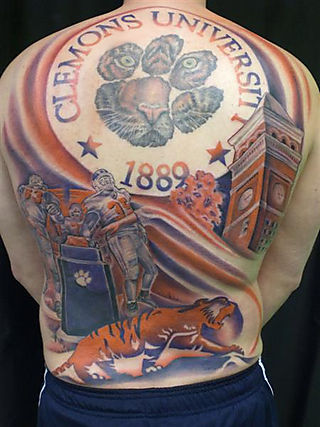 2 season tickets for football :: $3500. a tattoo to show your school spirit